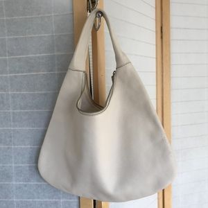 Banana Republic ivory leather hobo bag zips closed
